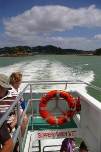 Leaving Paihia behind to look for dolphins and big holes.
