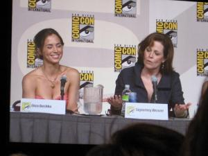 In the Wonder Women panel, Sigourney Weaver taught Eliza Dushku a thing or two about grace, class, and how to kick some real ass.